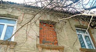Дом на улице Гасанова, Махачкала. Фото: Magomed_troll/2011, http://odnoselchane.ru/images/photogallery/cache/wm_2396_20110322_4.jpg