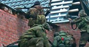 Сотрудники силовых структур во время спецоперации. Фото http://nac.gov.ru/