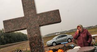Могила одного из погибших в станице Кущевской. Фото: Максим Тишин/Югополис