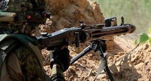 Солдат на передовой позиции. Фото: http://novosti.az/images/30154/02/301540286.jpg