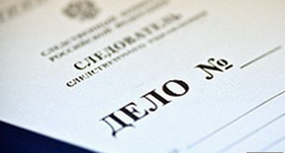 Папка с материалами уголовного дела. Фото: http://www.riadagestan.ru/news/incidents/na_eks_ministra_stroitelstva_zhkkh_dagestana_zaveli_ugolovnoe_delo/