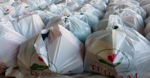 """Пакеты с продуктами питания, которые раздавали участники благотворительной акции фонда """"Тешам"""" 22 января 2015 года. Фото: Fondtesham.ru"""