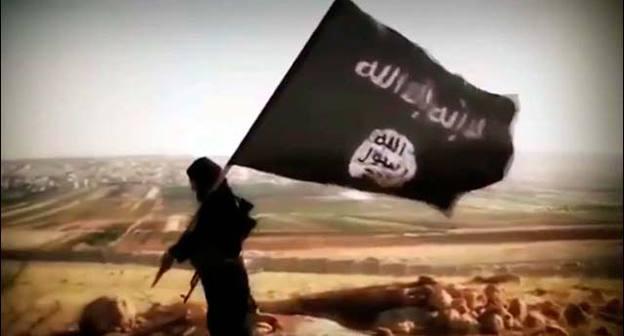 Флаг «Исламского государства» (ИГ — признано террористической организацией, его деятельность в России запрещена). Фото: VostockPhoto http://www.vostock-photo.com/