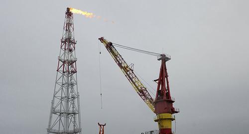 Нефтяной факел. Фото: Sputnik/ Maxim Blinov/ http://ru.sputnik.az/world/20160122/403464282.html