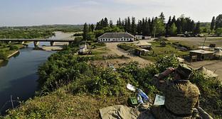 Пограничник на границе Грузии и Абхазии. Фото: © Sputnik/ Михаил Мордасов, http://sputnik-georgia.ru/incidents/20160522/231788973.html