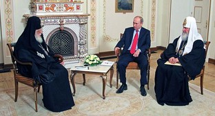 Патриарх Грузии Илия II на встрече с президентом России и главой Русской православной церкви. Фото: Kremlin.ru
