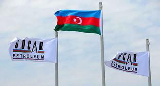 Флаги нефтяная компания Азербайджана (SOCAR) и Азербайджана. Фото: http://teknoblog.ru/wp-content/uploads/2014/01/Socar.jpg