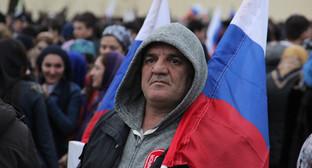"""Участник митинга в Грозном, март 2015 года. Фото Ахмеда Альдебирова для """"Кавказского узла"""""""